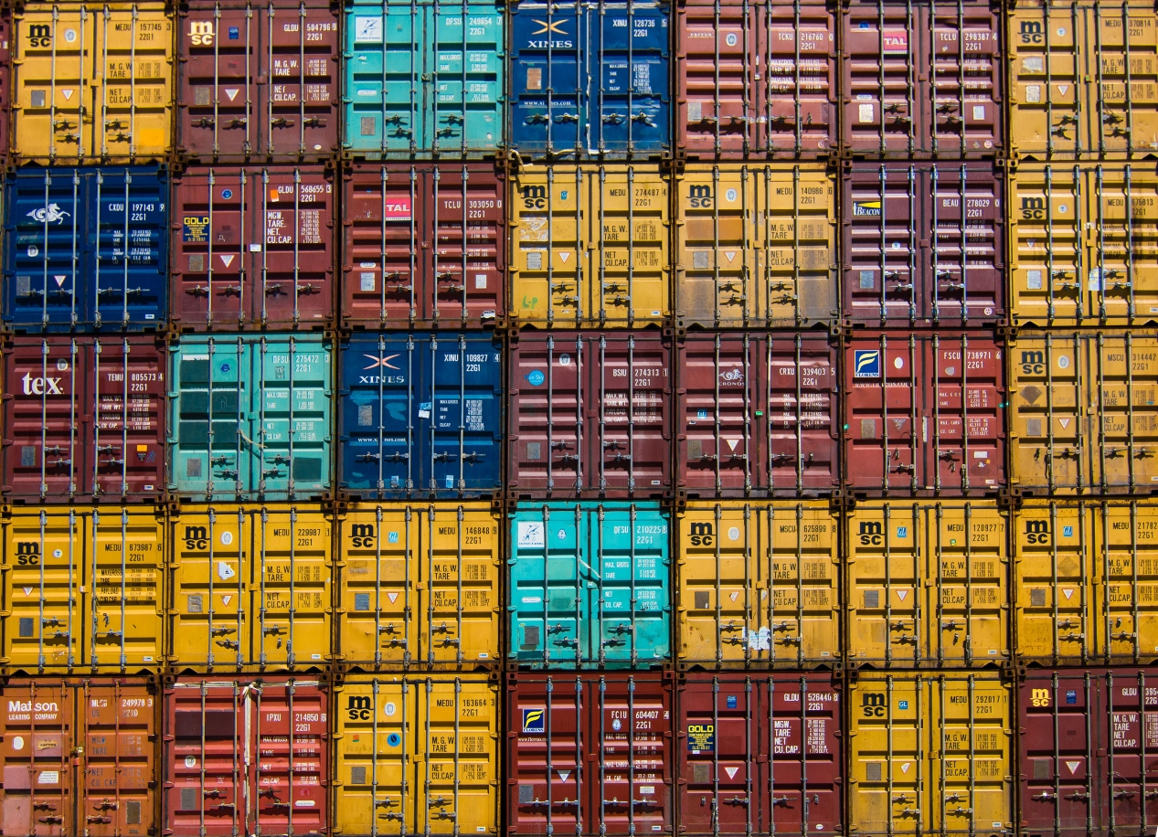 multicolored-shipping-containers-stacked-on-top-of-one-another