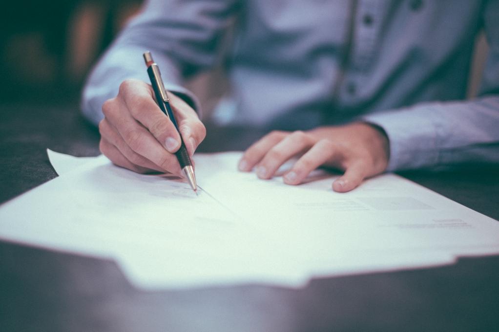 man-signing-document