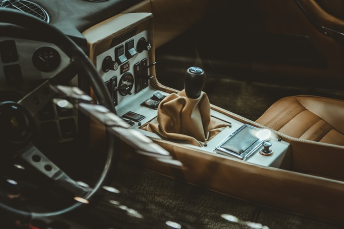 the interior of an old car, feat. gear shift