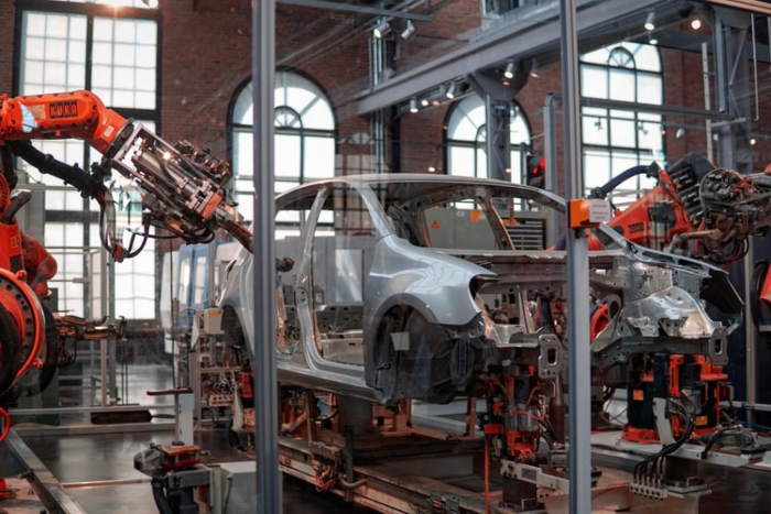 car being built in a factory